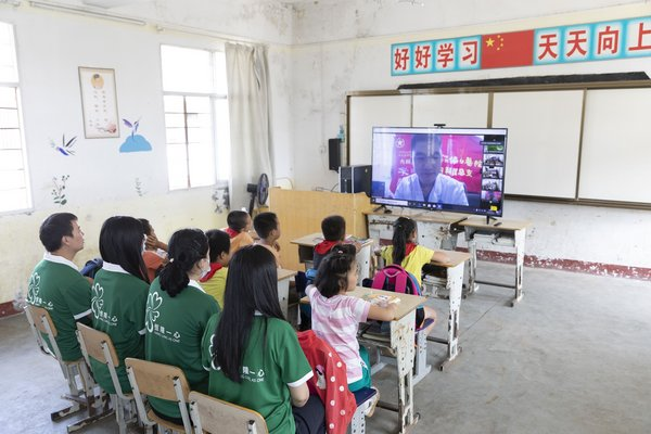 Volunteers from Heartland 66 in Wuhan work together with the Wuhan Union Hospital to offer online health talks for students at a remote rural school