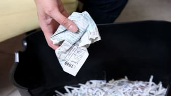 picture of crumpled tax form being thrown away