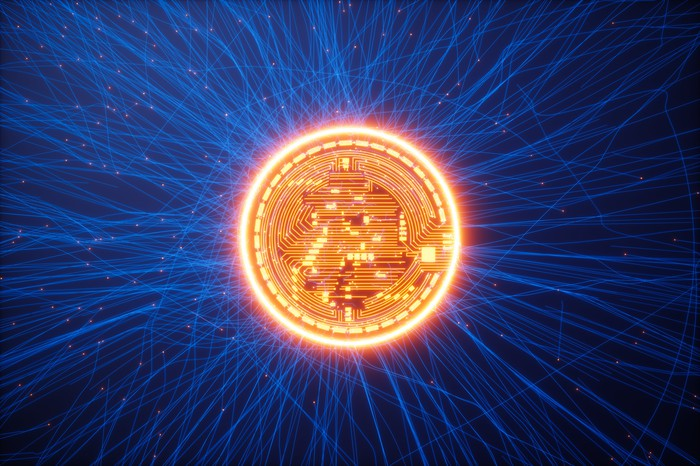 Glowing Bitcoin icon on a blue background with nodes stretching out.